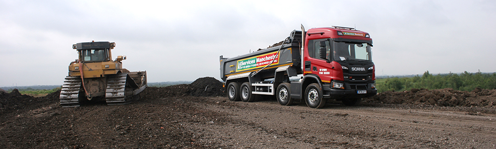 Landfill restoration with tipper truck and bulldozer